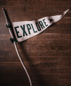 image of a flag with the words Explore