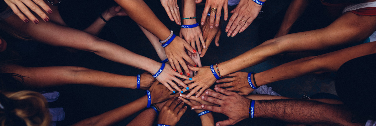 Many hands coming together