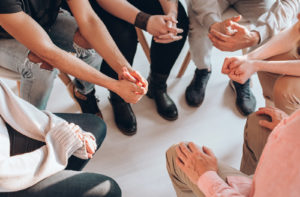 Close up of hands during group discussion