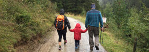 family hiking with their child